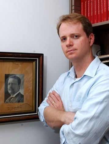 Professor Eric Raunchway with a photo of Teddy Roosevelt